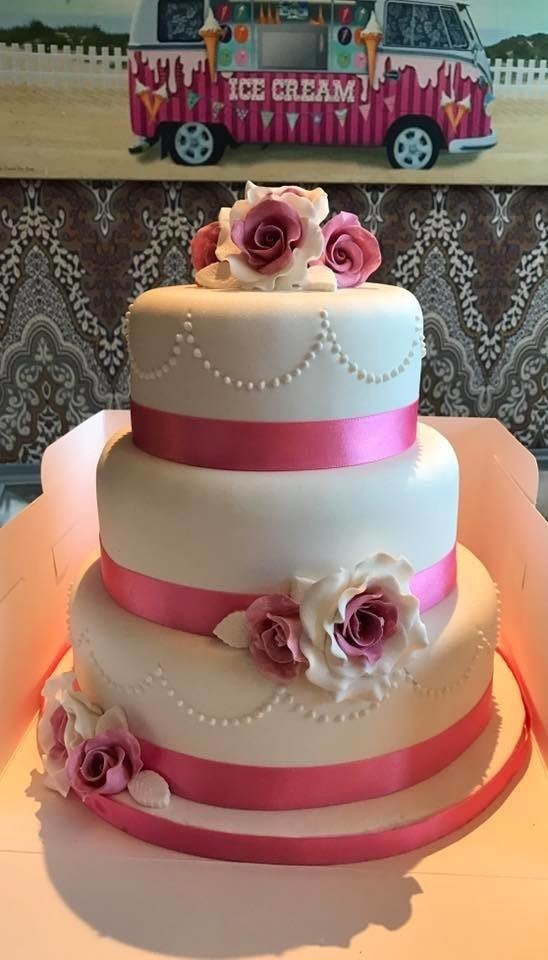 Pink theme wedding cake! All flowers are hand made.