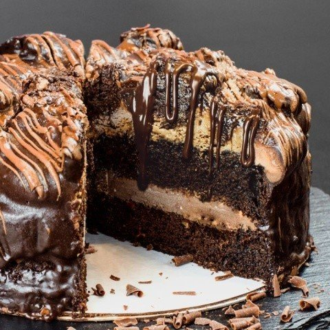 A rich chocolate frosting sandwiched between a spongy chocolate cake!