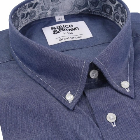 100% cotton with a denim twist and Blue Rock print collar and cuff detail.