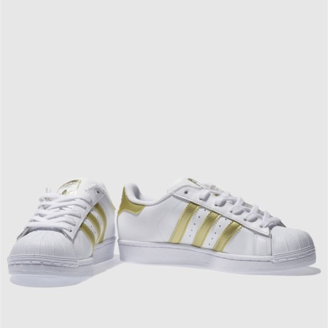 Save 49% on these Adidas white & gold superstar youth trainers