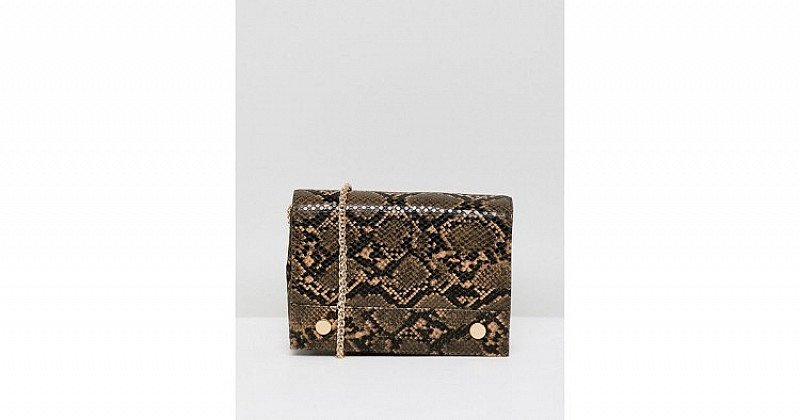 UP TO 50% OFF ALL CHRISTMAS GIFTS - French Connection faux snakeskin envelope back with chain strap!