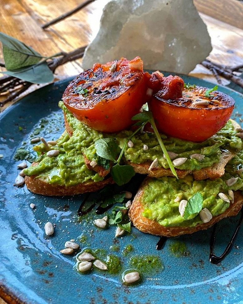 Try our Avocado on Toast served with Roasted Tomato & Balsamic Glaze!