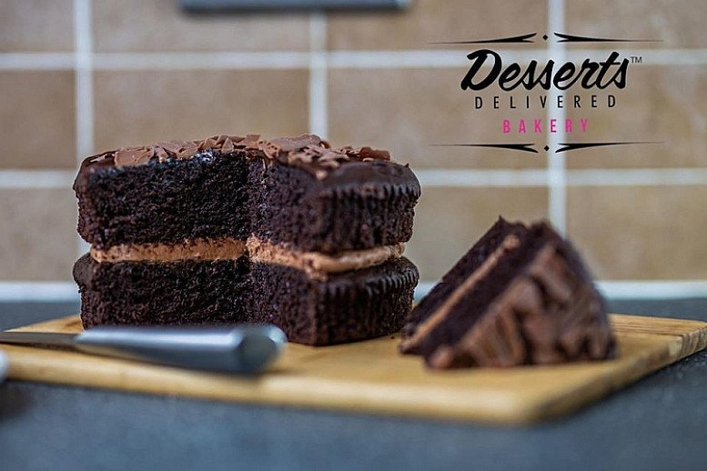 Gooey moist chocolate fudge cake hand made by one of our many expert bakers - Making lock-down tasty