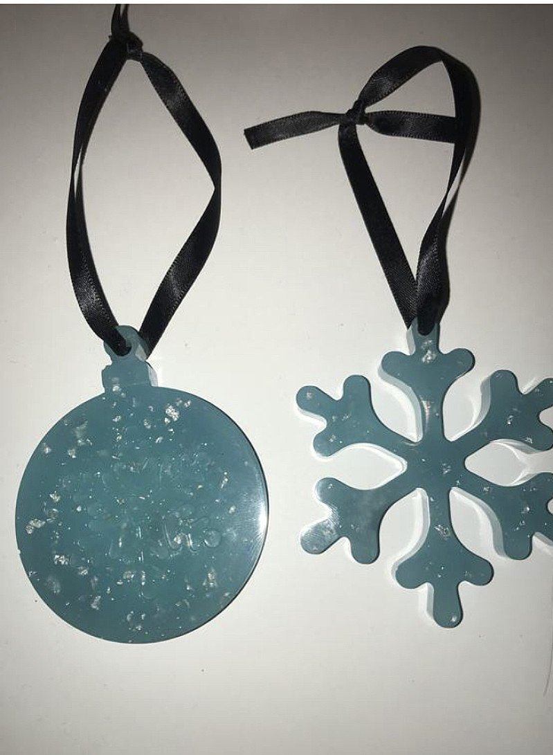 Handmade resin glow in the dark two baubles