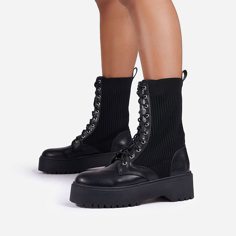 Save on these Soulmate Ribbed Lace Up Ankle Biker Boot In Black Faux Leather