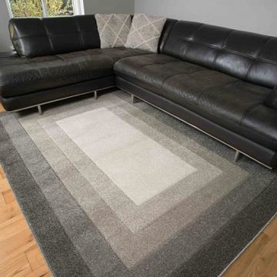 Soft layered bordered rug