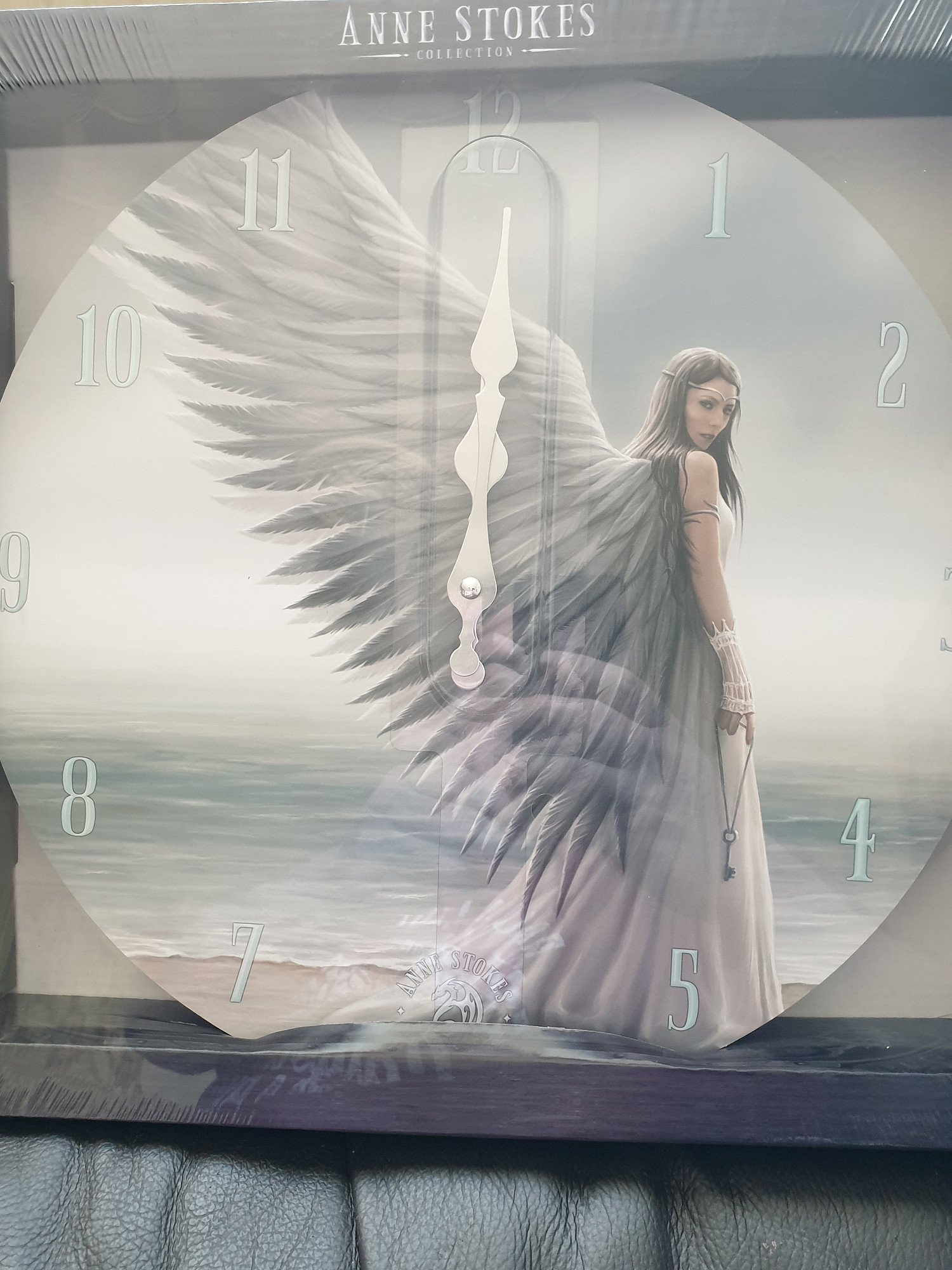 WIN an Anne Stokes Aly Fell Wall Clock!