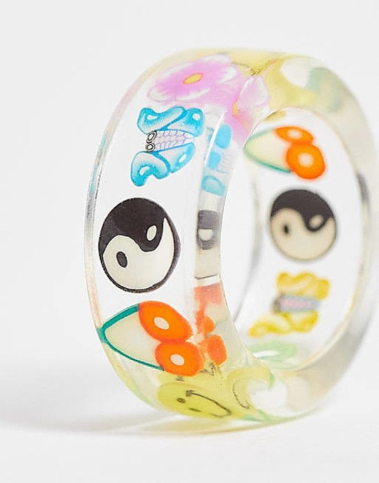 ASOS DESIGN plastic ring with trapped kitsch charms in clear current price - £6.00!