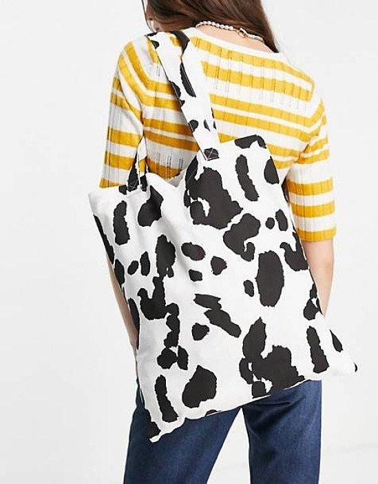 ASOS DESIGN cotton shopper bag in cow print current price - £8.00!